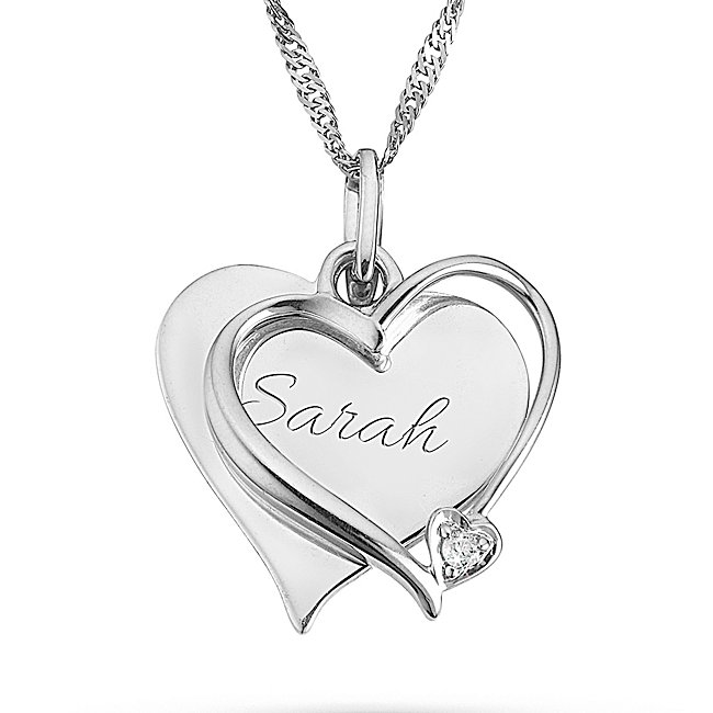 "Let her know she holds a very special place in your heart with this personalized necklace. Engrave a loving message just for her to this sterling silver necklace with glittering diamond accent for a gift she'll never forget-A wonderful personalized birthday or anniversary gift-18"" chain-One .03 ct wt diamond-Store in original pouch. 03 Ct Diamond Heart Necklace, In Silver, Front Engraving, Velvet/Silver/Metal, By Things Remembered."