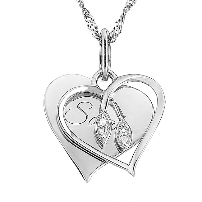 "There's no better way to tell her you're hers forever than with this necklace personalized with your loving words. Four dazzling diamonds drip from the center of the heart to create a stunning piece of jewelry she'll adore. Make this a gift only you can give with your engraved words that keep you always in her heart-A wonderful personalized birthday or anniversary gift-18"" chain-Four .03 ct wt diamonds-Store in original pouch. 03 Ct Intertwined Diamond Necklace, In Silver, Front Engraving, Velvet/Silver/Metal, By Things Remembered."