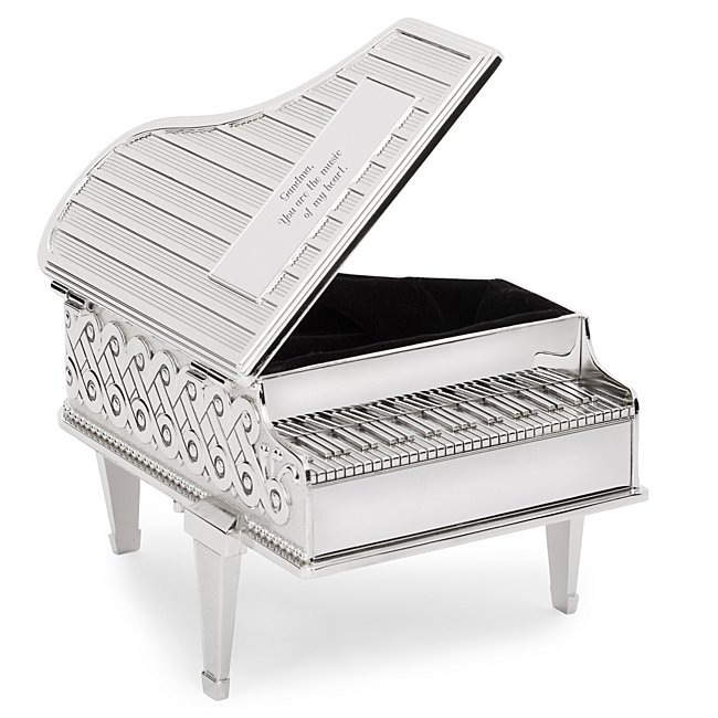 The personalized Silver Piano-Shaped Music Box is the perfect timeless gift for that one-of-a-kind lady. Intricate designs surround the piano and, when opened, a lush velvet interior is revealed. When wound, this gorgeous gift plays Fur Elisa. Engrave the plate with a name or monogram and heartfelt message. -W: 5.7 x D: 2.0 x H: 3.5 -Plays Fur Elisa when wound up -Great personalized gift for wife, girlfriend, mother, grandmother, friend, sister, anniversary, holiday, birthday. Silver Piano-Shaped Music Box, In Black, Zinc Alloy/Zinc/Silver, By Things Remembered.