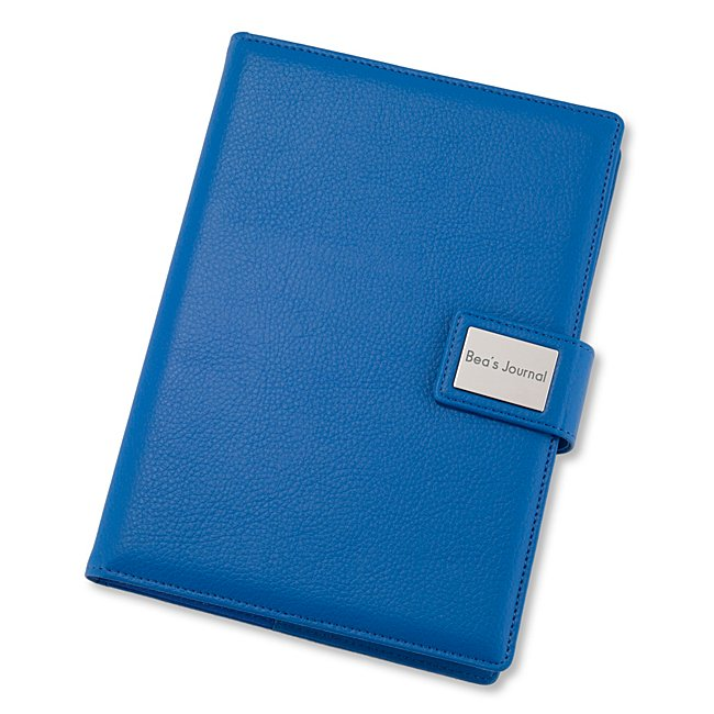 "Stay on top of notes, lists and everything worth writing down with our personalized Medium Blue Pebble Grain Journal. Solid and sleek, the leatherette journal is filled with 120 sheets of lined paper for all your jotting needs. Engrave a monogram, date or job role on the front plate for a bonus personal touch. -Size: 6.5"" W x 8.7"" H x 1.4"" D -Material: Leatherette, Paper -Inspiration: A great gift for a recent graduate, new coworker or friend. Medium Blue Pebble Grain Journal, By Things Remembered."