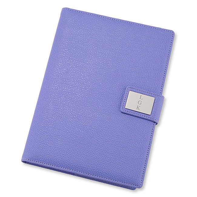 "Stay on top of notes, lists and everything worth writing down with our personalized Medium Purple Pebble Grain Journal. Solid and sleek, the leatherette journal is filled with 120 sheets of lined paper for all your jotting needs. Engrave a monogram, date or job role on the front plate for a bonus personal touch. -Size: 6.5"" W x 8.7"" H x 1.4"" D -Material: Leatherette, Paper -Inspiration: A great gift for a recent graduate, new coworker or friend. Medium Purple Pebble Grain Journal, By Things Remembered."