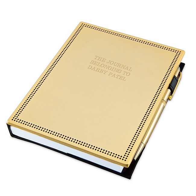 "Make sure they have a place to jot down every important note with our Gold Journal and Pen Set. The journal features a gold stainless steel cover with a beaded border and comes with a gold ballpoint pen for a complete office set. Engrave both the journal and pen with a name, message, significant date or favorite quote. -Contents: Includes 136-page journal and pen -Size: 5.1"" W x 6.7"" H x 1"" D; 136 pages of paper -Material: Stainless Steel, Paper -Inspiration: A great gift for a graduation, new job, promotion or work anniversary. Gold Journal And Pen Set, By Things Remembered."