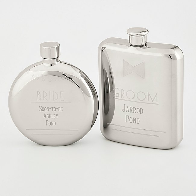 "Celebrate the big day with many toasts before and after the vows thanks to our Bride and Groom Flask Set. The coordinating stainless steel set includes one rectangle ""groom"" 6-oz. flask, detailed with a bow tie, and one round ""bride"" 4.5-oz. flask detailed with a necklace. Engrave both flasks with their name, the special date or their family surname. -Contents: Includes 6-oz. Groom flask and 4.5-oz. Bride flask -Size: 5.6"" W x 8.1"" H x 1.5"" D (Packaged) -Material: Stainless Steel -Care Instructions: Hand Wash -Inspiration: A great gift at a bridal shower, at a bachelor/bachelorette party or at a wedding reception. Bride And Groom Flask Set, Steel, By Things Remembered."