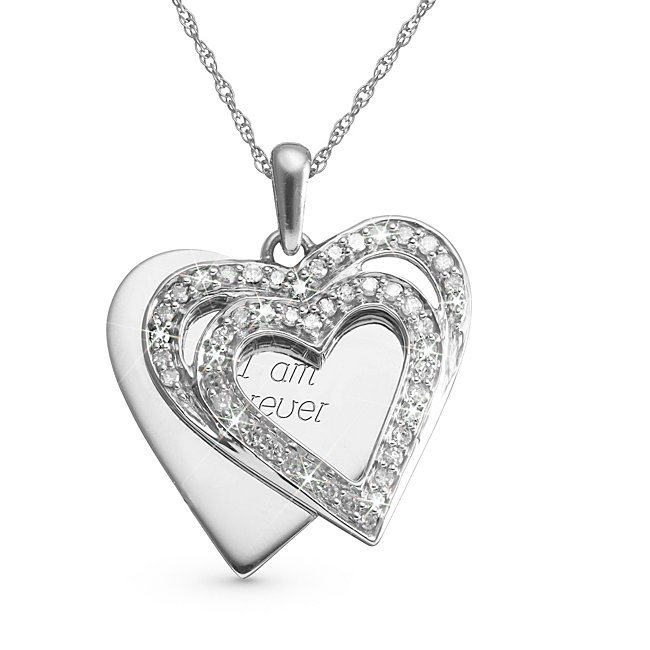 This fun, double-heart design can carry your own special engraved message. The 49-round-cut diamonds make this piece stand out in our collection, and it will look impressive hanging from her neck. The pendant is accompanied by a Sterling Silver rope chain- Diamonds are HI color, which means they are near colorless- Clarity for the diamonds are I2/I3- Comes with a free keepsake box, perfect for engraving that special message.