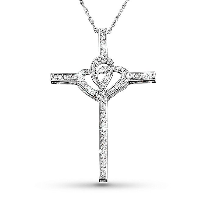 "You and your wife normally just exchange cards and go out to a nice dinner on your anniversary. But this year is a big one - you're celebrating 25 years of marriage. Really surprise her with this sparkling diamond necklace. Sterling silver, it features a cross with interlocking hearts in the center, both encrusted in brilliant diamonds, symbolizing the day you faithfully joined your hearts together as one. The glittering diamonds are HI color, meaning they are near colorless, with clarity of I2/I3. When she opens this gift, her jaw is sure to drop and her heart will skip a beat as she reflects on the day she said, ""I do."" - Online only - Presented in an engravable box - make it even more meaningful by adding your personal message - A great holiday, birthday or Mother's Day gift. 33 Ct Diamond Double Hearts Cross Necklace, In Silver, Center Monogram, By Things Remembered."